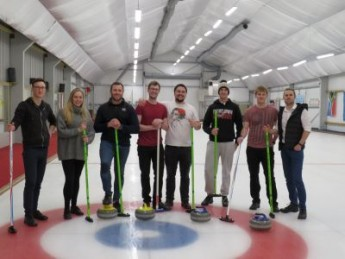 Assurity Consulting team learning curling